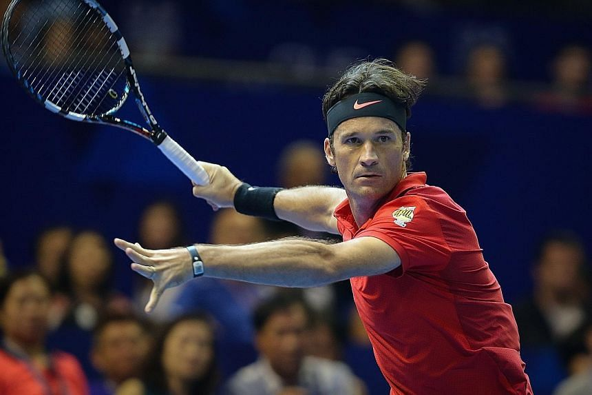 Carlos Moya playing for the Singapore Slammers in last month's International Premier Tennis League. He joins Boris Becker, Michael Chang, Amelie Mauresmo and Goran Ivanisevic as some of the supercoaches on tour.