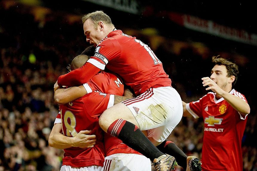 Wayne Rooney (top), celebrating Anthony Martial's opener against Swansea, scored the winner with his first Premier League goal since October.