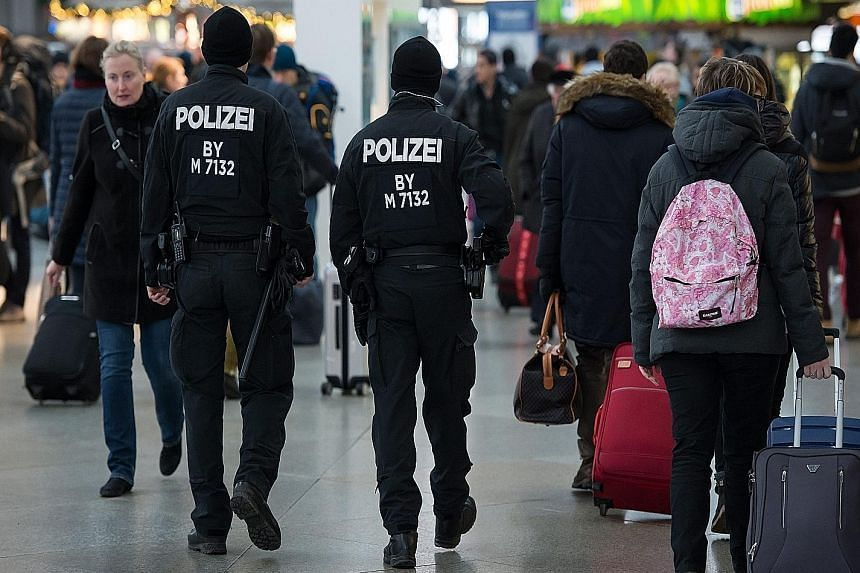 German police patrolling the Central Railway Station in Munich yesterday. The city was partially evacuated following a terrorist threat on New Year's Eve.