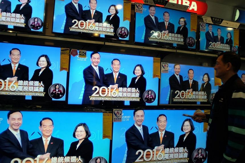 Taiwanese presidential candidates (from left) Eric Chu of the ruling Kuomintang, James Soong of the People First Party, and Tsai Ing-wen of the Democratic Progressive Party during the second and final televised debate yesterday. Ms Tsai, widely consi
