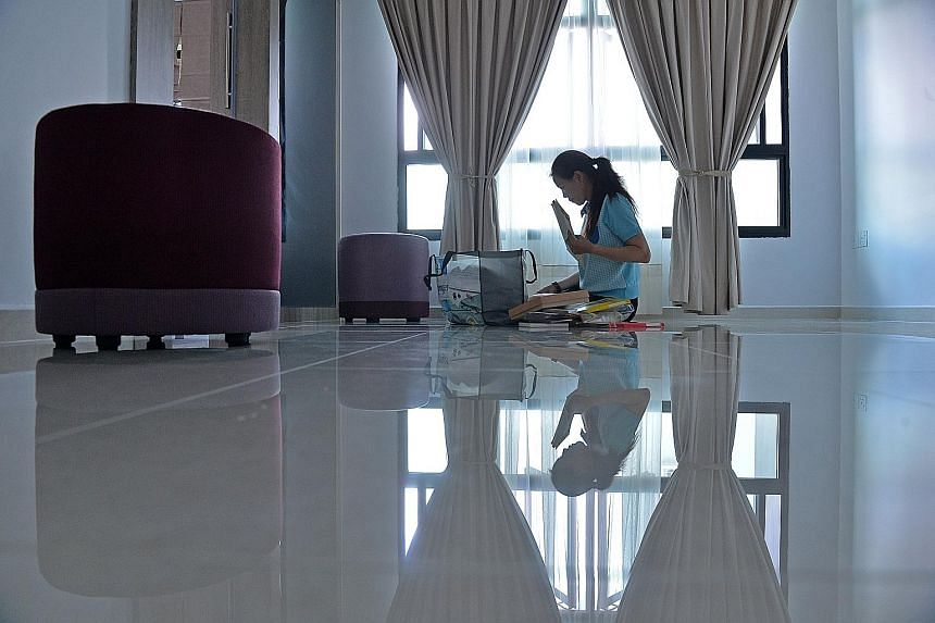 Madam Serene Tay in her new flat, for which renovations were recently completed. She received the keys to her Choa Chua Kang unit in October. She is taking her time to move in, but intends to be settled in before Chinese New Year next month.