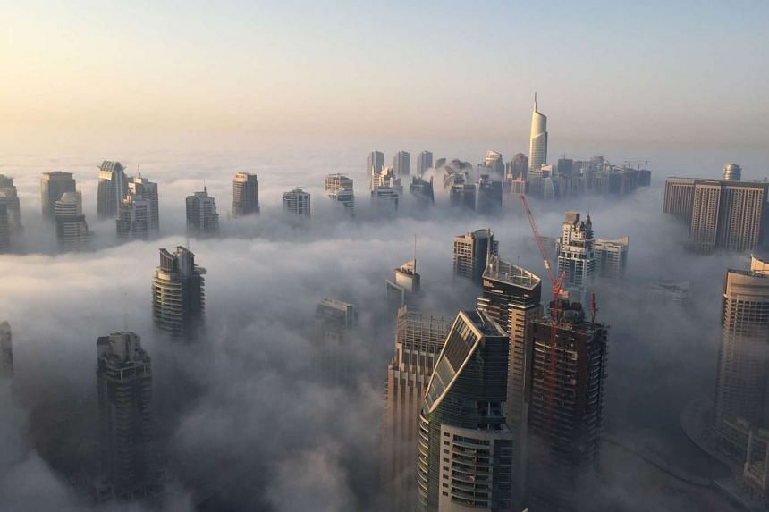 Part of the skyline of Dubai covered in an early morning fog on Oct 5, 2015.