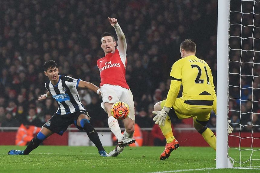 Koscielny (centre) knocks the ball past Newcastle keeper Rob Elliot to score the only goal of the match.