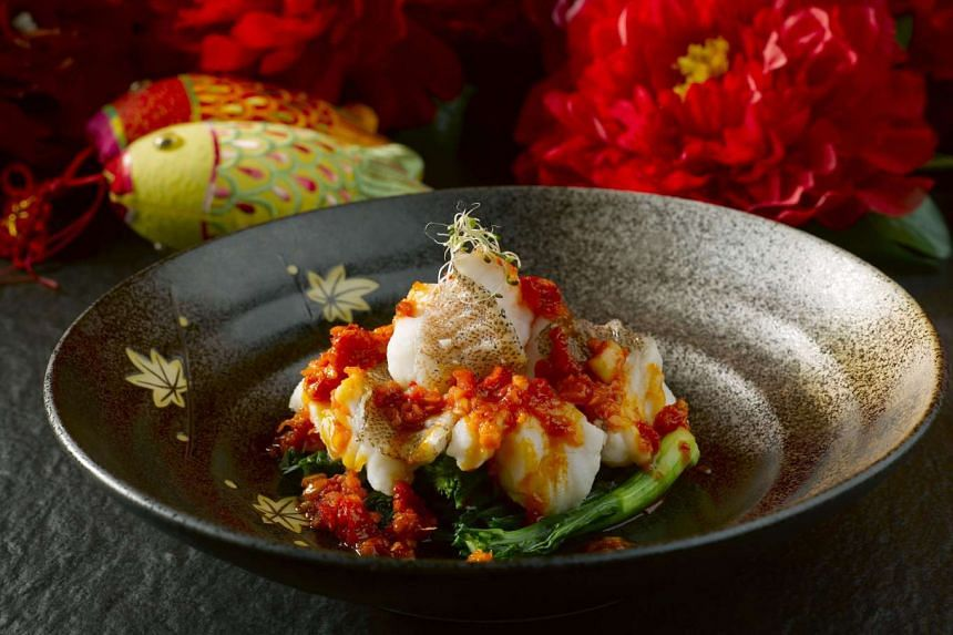 Steamed red grouper fillet on a bed of organic vegetables from Peony Jade.