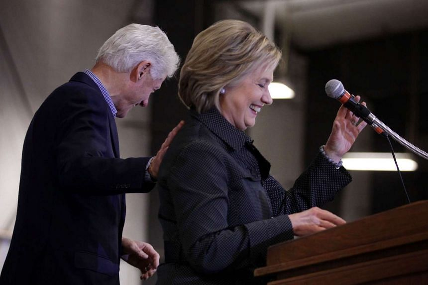 Democratic presidential candidate Hillary Clinton, and her husband and former President Bill Clinton share a moment on stage on Nov 15, 2015.