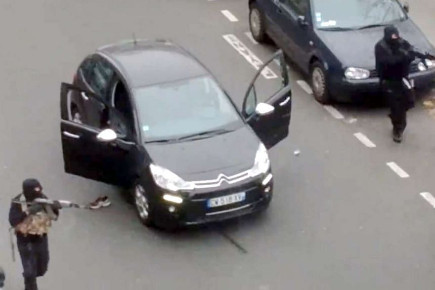Hooded gunmen aiming Kalashnikov rifles towards a police officer, before shooting him dead after leaving the office of the satirical weekly newspaper Charlie Hebdo on Jan 7. 2015.