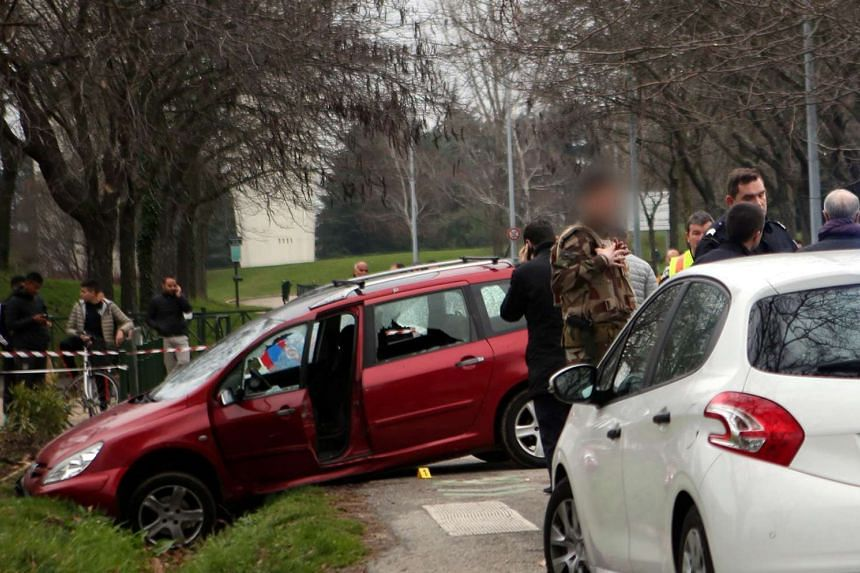 The car in a ditch after a man tried to ram the vehicle into French troops protecting a mosque in Valence, France, on Jan 1, 2016.