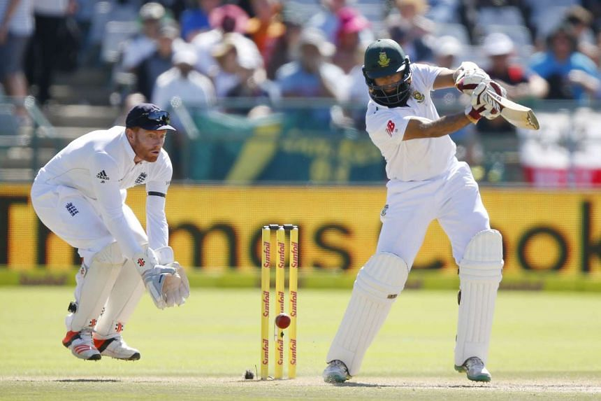 South Africa's Hashim Amla plays a shot as England's Jonny Bairstow looks on during the second cricket test match in Cape Town, South Africa on Jan 3.