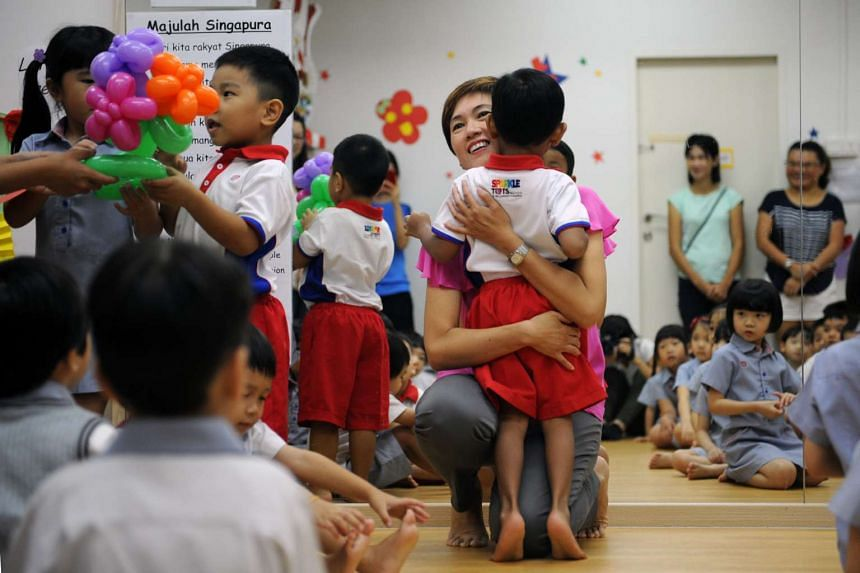 Josephine Teo welcoming children back to school at the PCF Sparkletots Childcare at Bishan North on Jan 4.