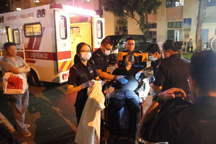 One of the casualties being sent to hospital after a brawl at Yishun Street 22.