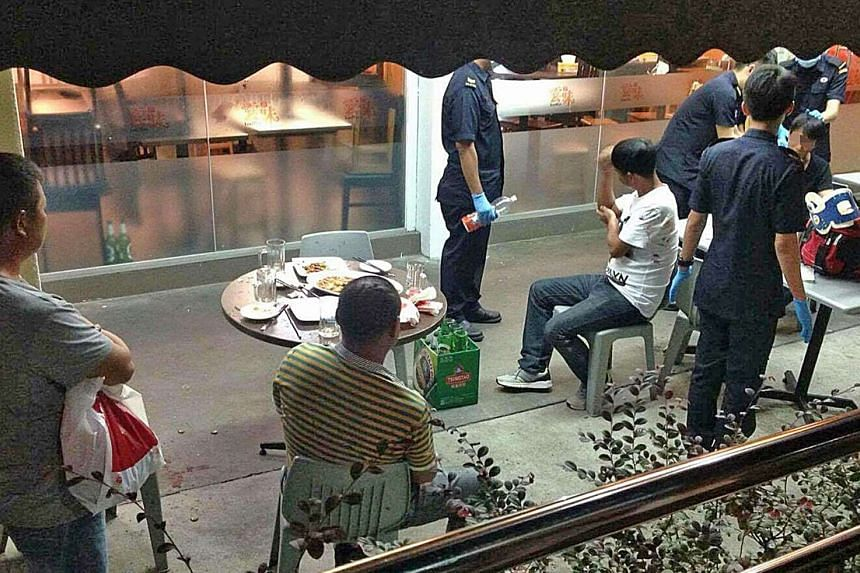 Singapore Civil Defence Force officers attended to the wounds of three men at the scene.