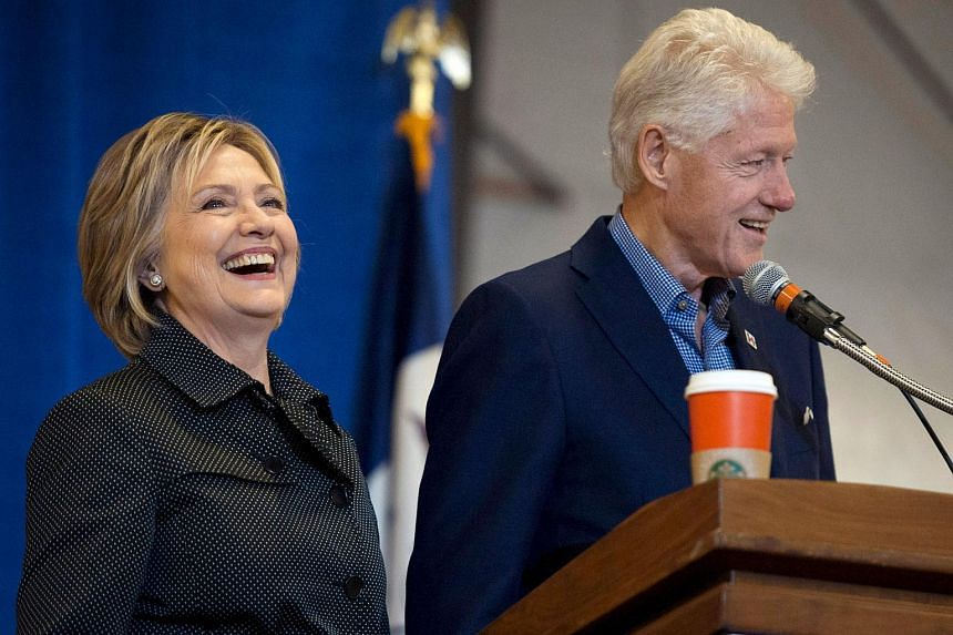 Former US President Bill Clinton and Democratic US presidential candidate Hillary Clinton take the stage in Ames, Iowa on Nov 15, 2015.