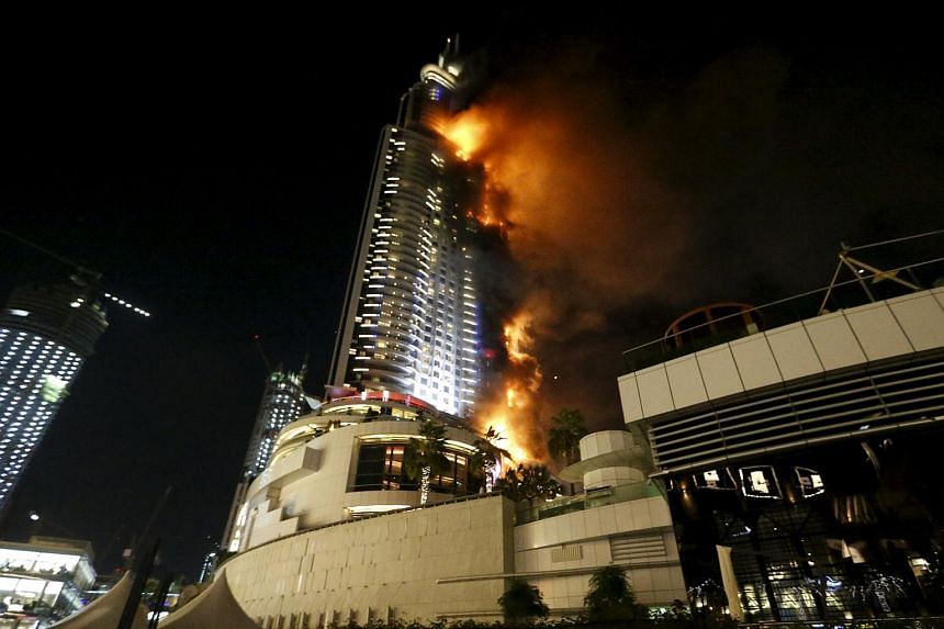 A fire engulfs The Address Hotel in downtown Dubai in the United Arab Emirates on Dec 31, 2015.