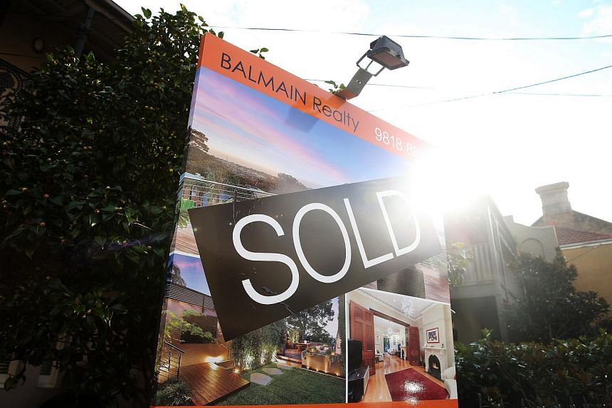 """A """"Sold"""" sign is displayed outside a house in the suburb of Balmain in Sydney, Australia on June 18, 2015."""