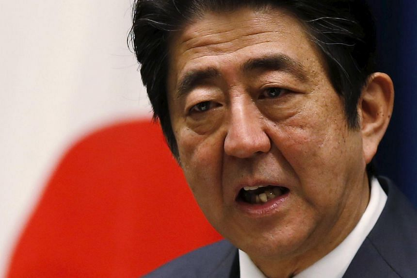Japan's Prime Minister Shinzo Abe addresses reporters on the first official business day of the New Year.