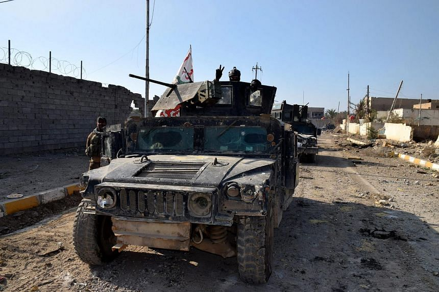 Eight Iraqi army trucks in the city of Ramadi, recaptured  from the Islamic state (ISIS) militants on Dec 28, 2015.