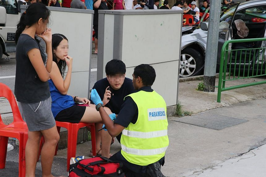 An injured woman being attended to by paramedics.