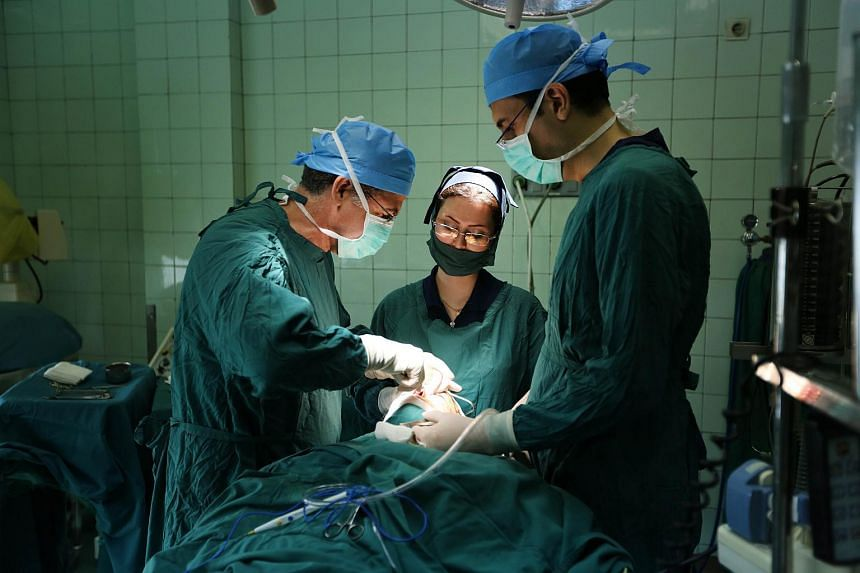 Iranian surgeon Javad Amirizad (left) performing a nose surgery at his private clinic in Teheran.