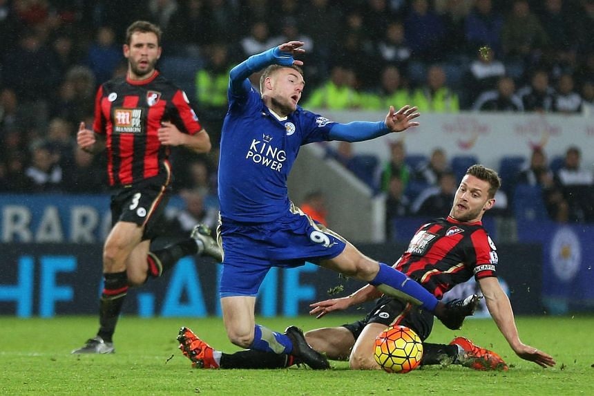 Leicester's Jamie Vardy is fouled by Bournemouth's Simon Francis.