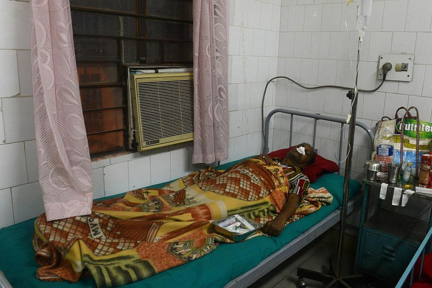 Injured local resident Gouranga Saha, 68, lies in a bed after receiving treatment at Siliguri Hospital following an earthquake in Siliguri on Jan 4.