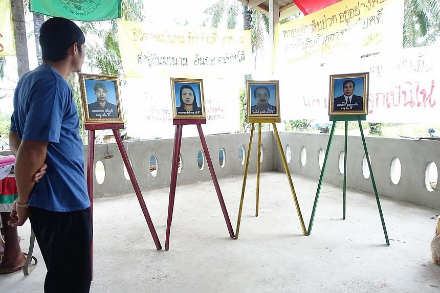 A memorial to four community leaders killed for their activism in Klong Sai Pattana, a small neighbourhood of about 70 families in Thailand's southern Surat Thani province.