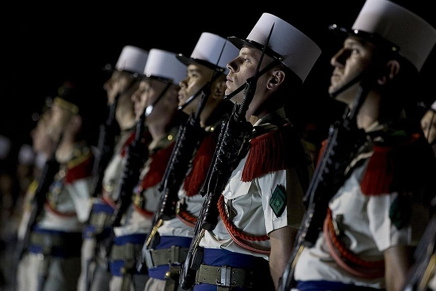 Members of the 13th Demi-Brigade of the French Foreign Legion forming a guard of honour during a visit by the French Defence Minister to the legion's base in the United Arab Emirates on Saturday. Minister Jean-Yves Le Drian was visiting French milita