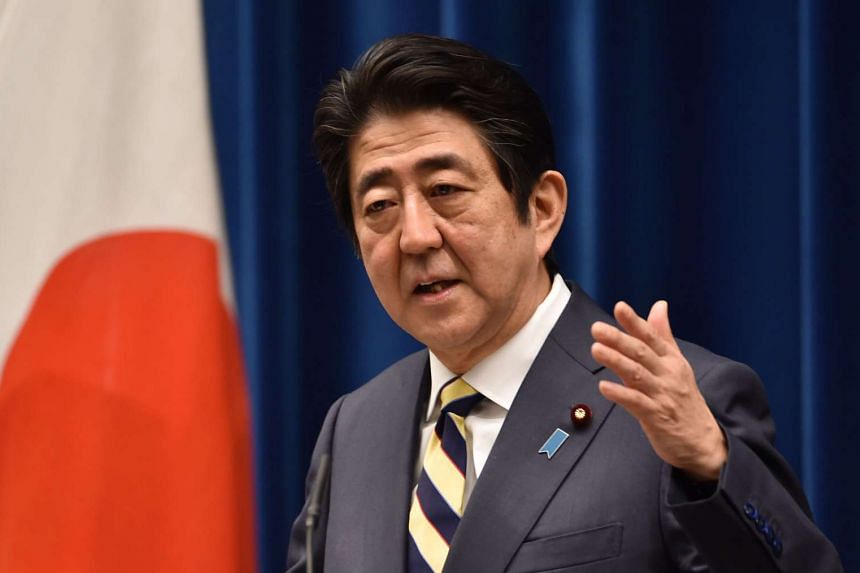 Japanese Prime Minister Shinzo Abe answers questions during his New Year press conference in Tokyo on Jan 4.