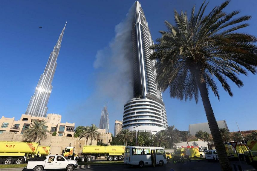 Plumes of smoke rise from the 63-storey Address Downtown Dubai hotel, a day after the hotel caught fire on New Year's Eve, in Dubai on Jan 1.