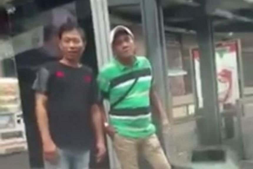 A screengrab showing two men who were seen harassing a ComfortDelgro taxi driver.
