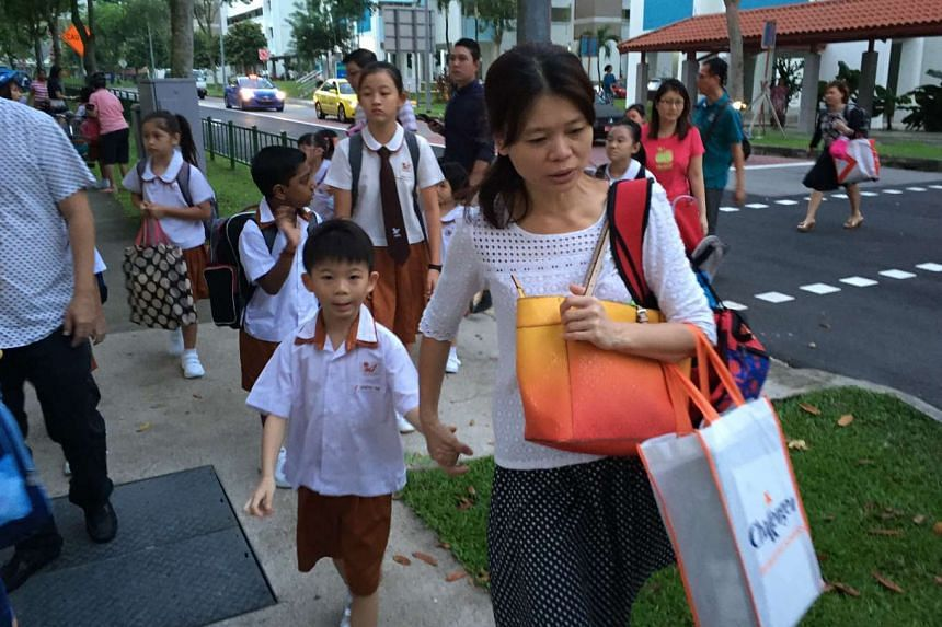Ahmad Ibrahim Primary School pupils arrive for the first day of school in 2016.