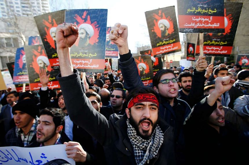 Iranian protesters with posters of the late Shi'ite cleric Nimr al-Nimr during a demonstration near the Saudi Arabian embassy in Teheran, Iran, on Jan 3.