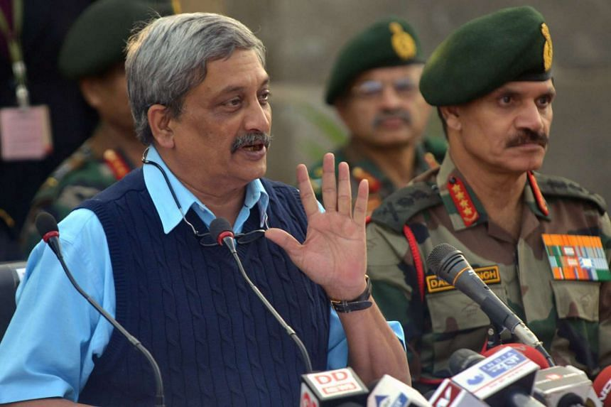 Indian Defence Minister Manohar Parrikar speaks to the media at the air force base in Pathankot on Jan 5, 2016.
