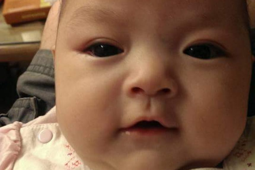 Mr and Mrs Huang's youngest daughter was diagnosed with eye cancer when she was just a few months old.