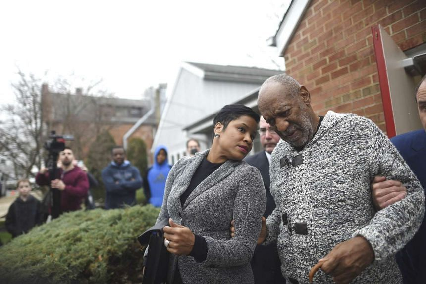Comedian Bill Cosby speaking to attorney Monique Pressley at the Montgomery County Courthouse in Elkins Park, Pennsylvania, on Dec 30, 2015.