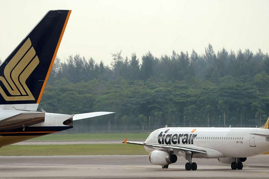 Tigerair and Singapore Airlines planes at Changi Airport.