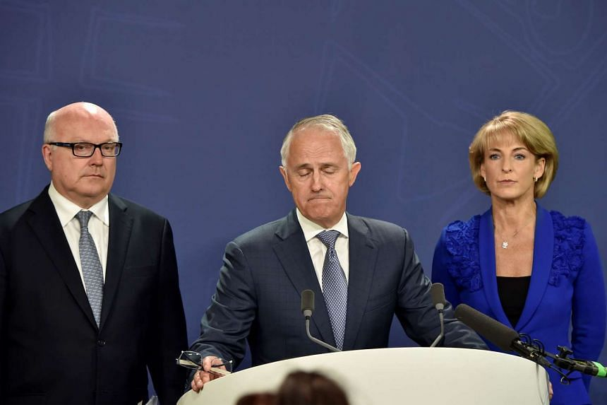 Australian Prime Minister Malcolm Turnbull (centre) speaking at a press conference with Attorney-General George Brandis (left) and Employment Minister Michaelia Cash on Dec 30, 2015.