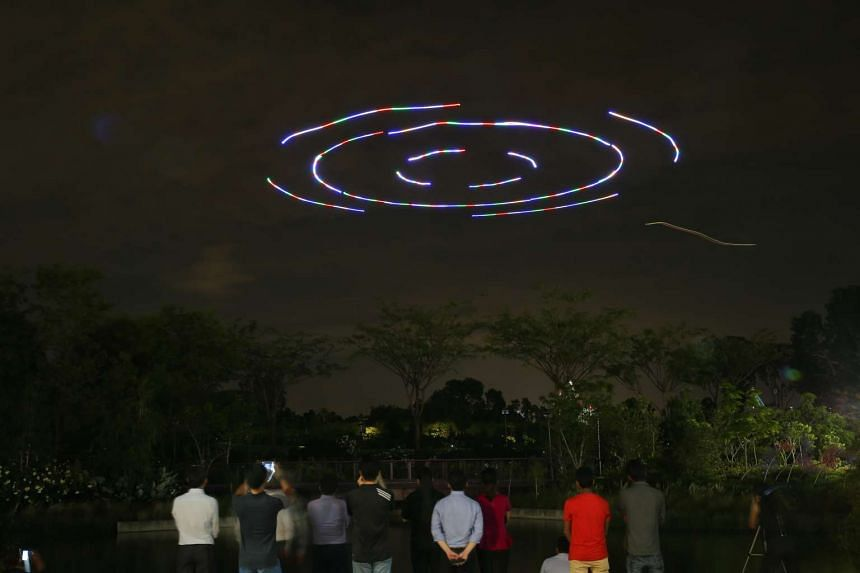 Drones flying in a formation during the preview.