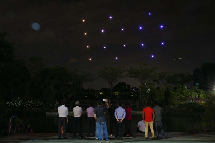 """The drones in a formation showing """"100"""", for SG100 at a preview."""