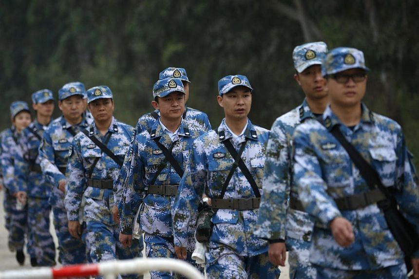 People's Liberation Army soldiers at the site of a landslide in Shenzhen on Dec 21, 2015.
