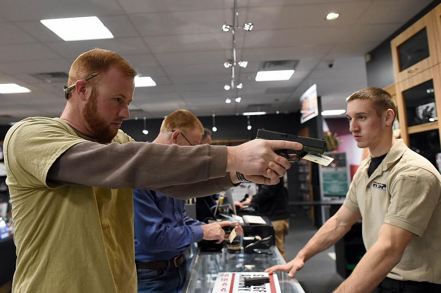 A man checking out a handgun for sale at a shooting range in Randolph, New Jersey, on Dec 9, 2015.