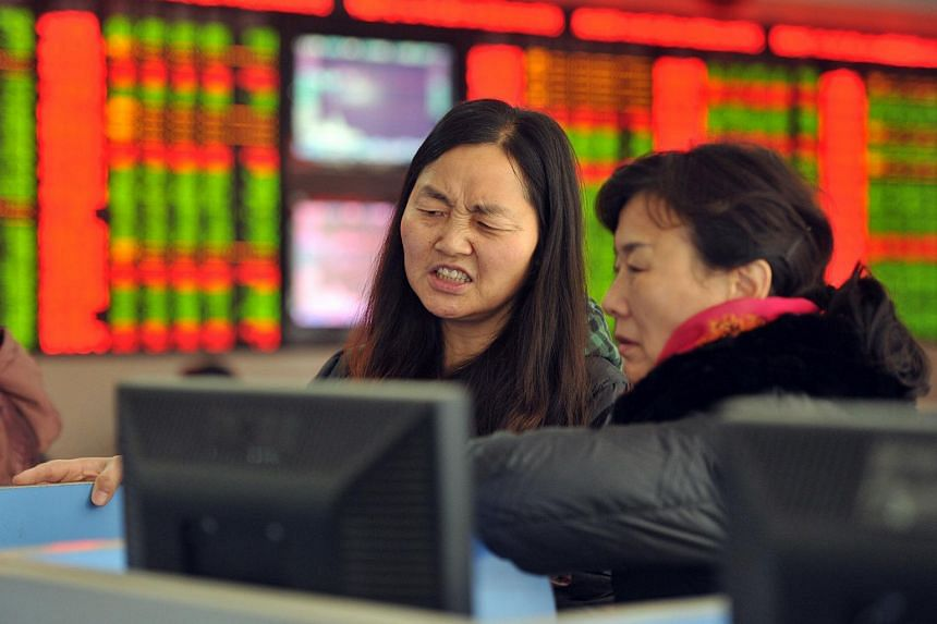 Investors at a stock firm in Fuyang on Jan 4.