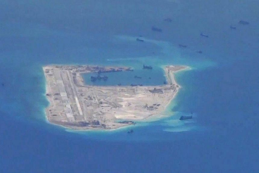 Chinese dredging vessels purportedly seen in the waters around Fiery Cross Reef in the disputed Spratly Islands in the South China Sea.