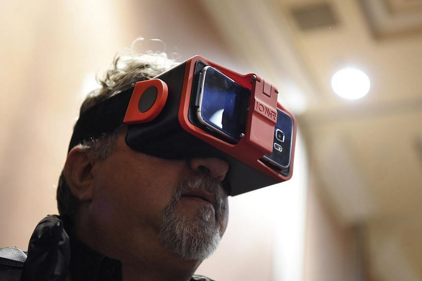 An attendee trying out a virtual reality headset at the 2016 Consumer Electronics Show in Las Vegas on Jan 4.