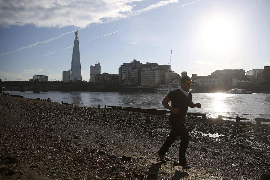 """The spire of St Margaret Pattens Church is dwarfed by 20 Fenchurch Street, also known as the """"Walkie Talkie"""" due to its distinctive shape, in the City of London business district, Britain. Many such towers now loom over a dwindling, but still impress"""
