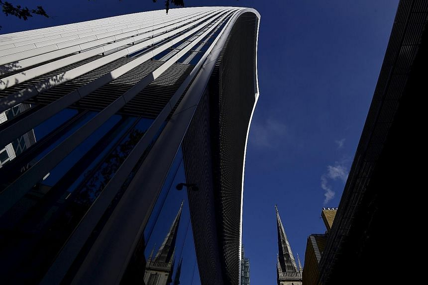 "The spire of St Margaret Pattens Church is dwarfed by 20 Fenchurch Street, also known as the ""Walkie Talkie"" due to its distinctive shape, in the City of London business district, Britain. Many such towers now loom over a dwindling, but still impress"