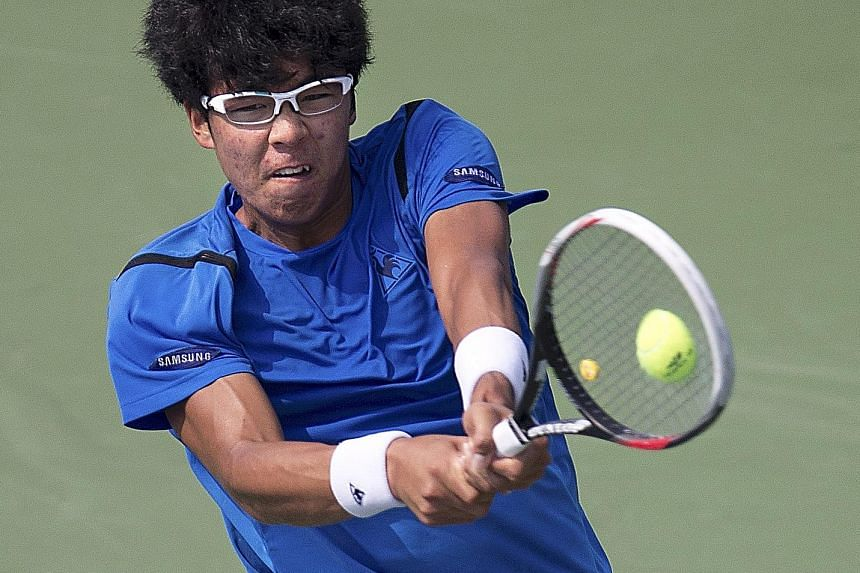 South Korea's 19-year-old Chung Hyeon, currently ranked 51st in the world, hitting a return to Switzerland's Stan Wawrinka during their second-round match at the US Open in New York last September.