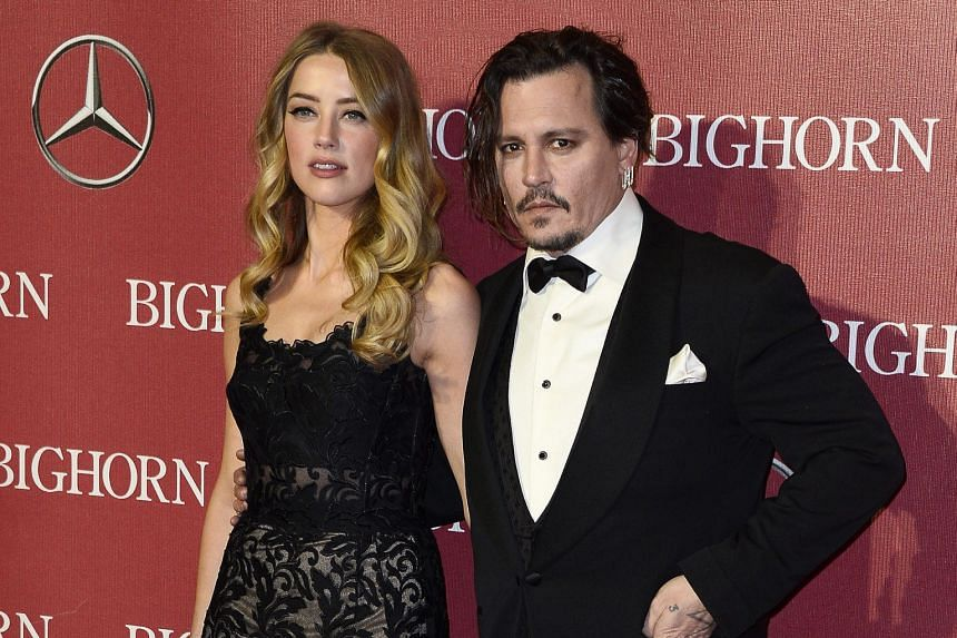 Actor Johnny Depp attended the awards ceremony with his wife Amber Heard (both above).