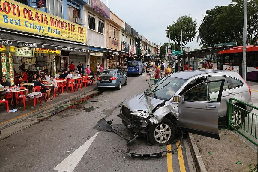 The accident left four people - the driver and passenger in the car, and two others who were diners at the eatery - injured and they were taken to hospital.