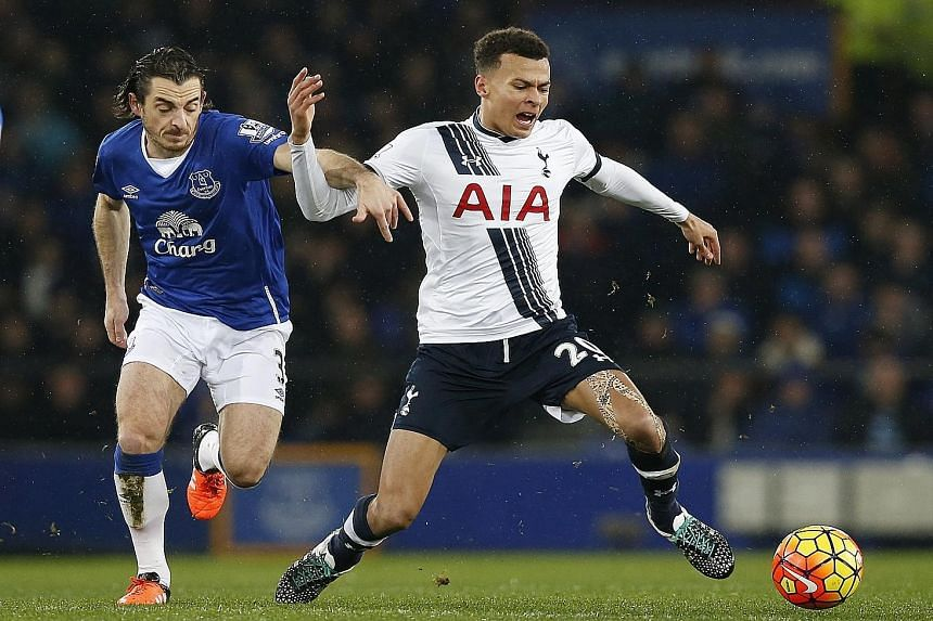 Tottenham's Dele Alli, who netted the equaliser just before half-time, showing his style as Everton's Leighton Baines struggles to catch him.