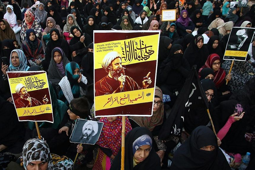 There have been protests in many places at the weekend against the execution of cleric Nimr al-Nimr, including (left) outside the Saudi Embassy in London and (below, left) in Karachi on Sunday. American Muslims protesting against Saudi Arabia's execu